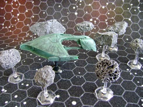 Romulan Warbird negotiates Asteroid belt
