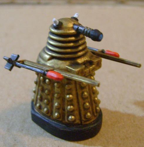 Gold Rocket art Dalek